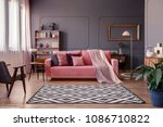 pink sofa with two blankets and ... | Shutterstock . vector #1086710822