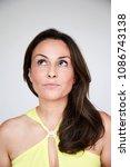 thoughtful brunette woman ... | Shutterstock . vector #1086743138