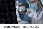 neurosurgeon showing human mri... | Shutterstock . vector #1086766652