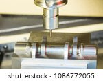 machining precision part by cnc ... | Shutterstock . vector #1086772055