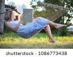 beautiful young girl lying and...   Shutterstock . vector #1086773438