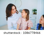 little girls trust a young... | Shutterstock . vector #1086778466