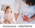 little girls trust a young... | Shutterstock . vector #1086780446