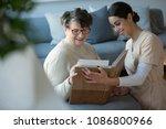 granddaughter and happy senior...   Shutterstock . vector #1086800966