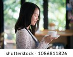asian women barista smiling  in ... | Shutterstock . vector #1086811826