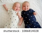 two adorable twin babies... | Shutterstock . vector #1086814028