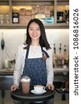 asian women barista smiling  in ... | Shutterstock . vector #1086816026