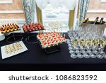 table with wine glasses  canape | Shutterstock . vector #1086823592