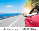 young woman in a car with a... | Shutterstock . vector #1086827096