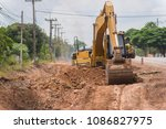 Worker Tracke Excavator On The...