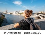 a young tourist woman admires... | Shutterstock . vector #1086830192