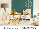 grey lamp next to chairs at... | Shutterstock . vector #1086830975