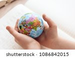 close up. child holds small... | Shutterstock . vector #1086842015