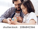 adult father helps son learn... | Shutterstock . vector #1086842366