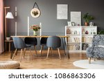 grey chairs at wooden table... | Shutterstock . vector #1086863306