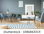 pouf on striped carpet in grey... | Shutterstock . vector #1086863315