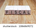 fiscal word in wooden cube | Shutterstock . vector #1086869072