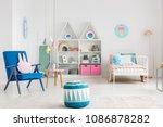 patterned pouf near blue... | Shutterstock . vector #1086878282