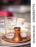 Small photo of Sarajevo, capital of Bosnia. Traditional handcrafted copper plated coffee filled with traditional foam Bosnian coffee served in an ornament Sarajevo set