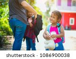 child with backpack behind the  ... | Shutterstock . vector #1086900038