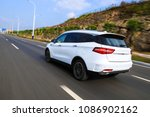 White suv flying through the national highway - stock photo