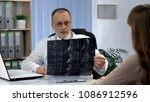 attentive surgeon looking at...   Shutterstock . vector #1086912596