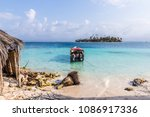 a view of a boat from isla... | Shutterstock . vector #1086917336