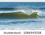 small beach break shore break... | Shutterstock . vector #1086943538