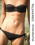 female body in black bikini... | Shutterstock . vector #1086949706