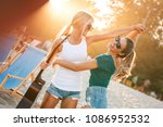 two young female friends... | Shutterstock . vector #1086952532