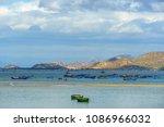 beach and boats at phan rang ... | Shutterstock . vector #1086966032