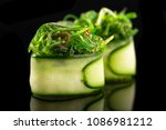gunkan sushi maki on the black... | Shutterstock . vector #1086981212
