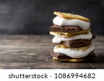 homemade smores on wooden table....   Shutterstock . vector #1086994682