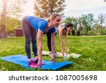 two fitness women doing... | Shutterstock . vector #1087005698