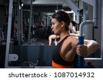 athletic young woman works out... | Shutterstock . vector #1087014932