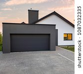 stylish house with garage and... | Shutterstock . vector #1087032335