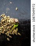 raw organic green cardamom or...   Shutterstock . vector #1087049972