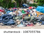 pile of old clothes and shoes... | Shutterstock . vector #1087055786
