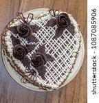 homemade dark sponge cake with...   Shutterstock . vector #1087085906