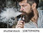 bearded man smokes vape  white... | Shutterstock . vector #1087094096