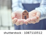 woman hand holding new home. | Shutterstock . vector #1087110512