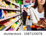 woman with smartphone in store. ... | Shutterstock . vector #1087133078