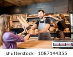 young woman client buying bread ...   Shutterstock . vector #1087144355
