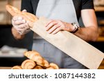 Seller Packing Bread Into The...