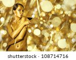 sexy naked golden woman with... | Shutterstock . vector #108714716