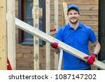 worker with wooden plank in... | Shutterstock . vector #1087147202