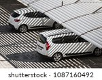 white clean cars on a parking... | Shutterstock . vector #1087160492