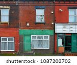 run down terraced houses on a... | Shutterstock . vector #1087202702