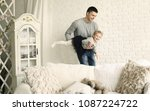 happy father playing with his... | Shutterstock . vector #1087224722