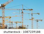 many cranes on building site  ... | Shutterstock . vector #1087239188